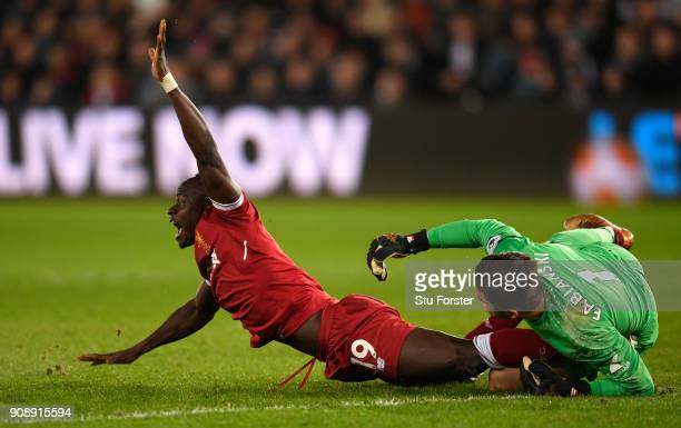 Liverpool player Sadio Mane dives in vain as Swansea goalkeeper Lukasz Fabianski saves during the Premier League match between Swansea City and...