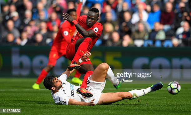 Liverpool player Sadio Mane is challenged by Jordi Amat of Swansea during the Premier League match between Swansea City and Liverpool at Liberty...