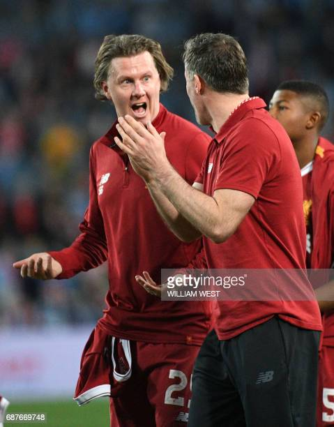 Liverpool player Steve McManaman shares a light moment with teammate Jamie Carragher after their endofseason friendly football match against Sydney...