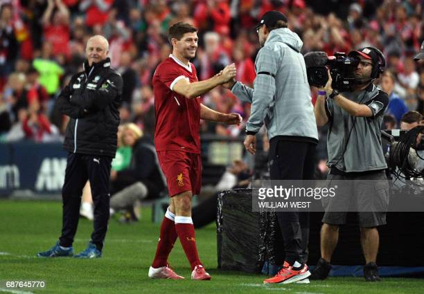 Liverpool player Steven Gerrard shakes hands with coach Jurgen Klopp after being substituted during their endofseason friendly football match against...