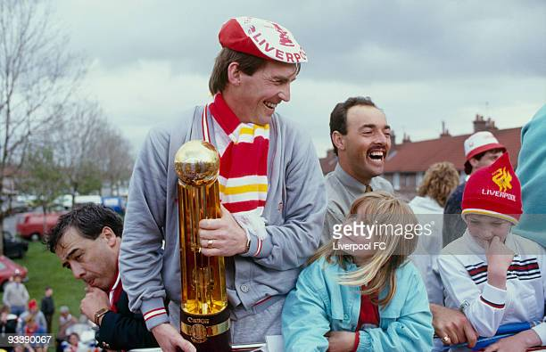 Liverpool player/manager Kenny Dalglish celebrates being the FA Cup and Canon League Division One champions and parades the trophies during a open...