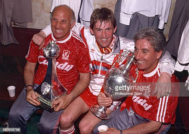 Liverpool player/manager Kenny Dalglish celebrates with his assistants Ronnie Moran and Roy Evans as Liverpool clinch the title following a 10...