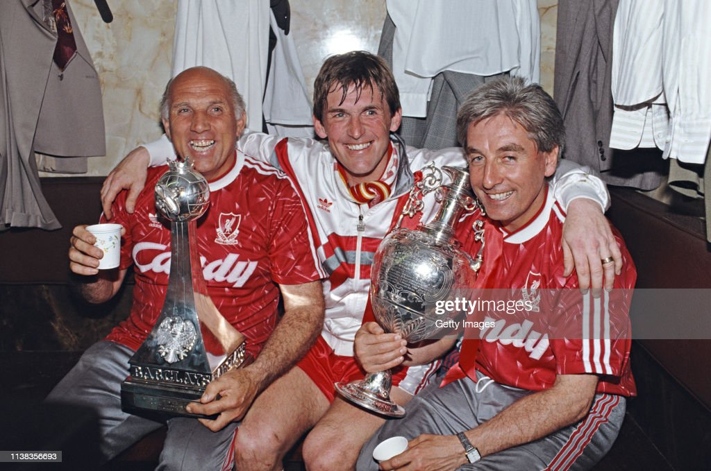 Liverpool Player Manager Kenny Dalglish Ronnie Moran and Roy Evans Celebrate 1990 Division One Championship : News Photo