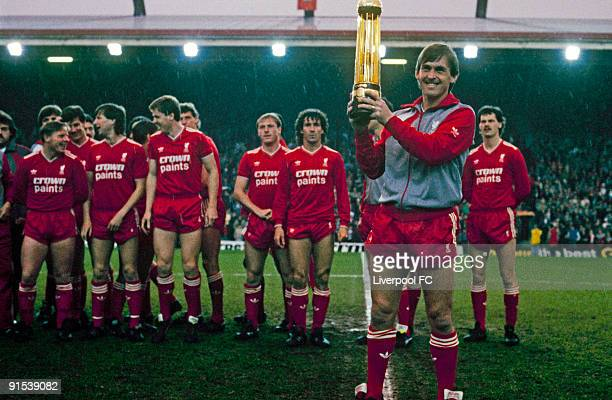 Liverpool player/manager Kenny Dalglish poses with the Canon League Division One trophy before the Screen Sport Super Cup SemiFinal Second Leg match...