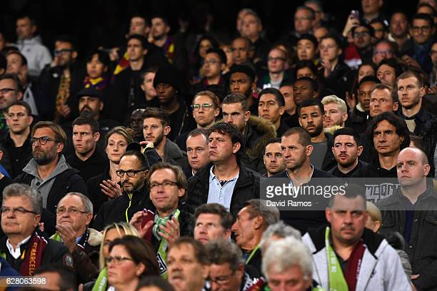 Liverpool players and Jurgen Klopp Manager of Liverpool are seen in the stands during the UEFA Champions League Group C match between FC Barcelona...