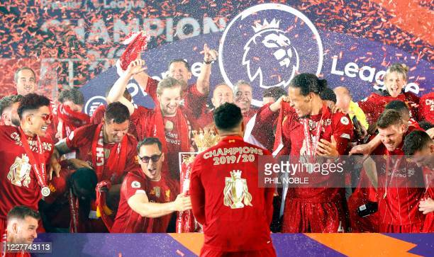 Liverpool players and staff celebrate during the Premier League trophy presentation following the English Premier League football match between...