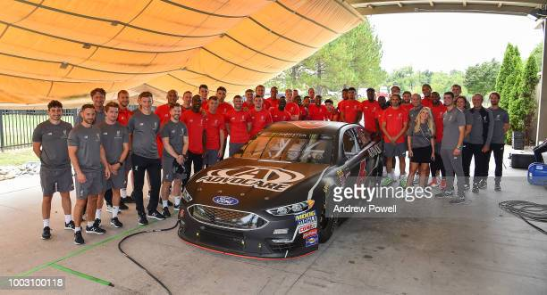 Liverpool players and staff pose for a group photograph at the end of the tour of Roush Fenway Racing on July 21 2018 in Charlotte North Carolina