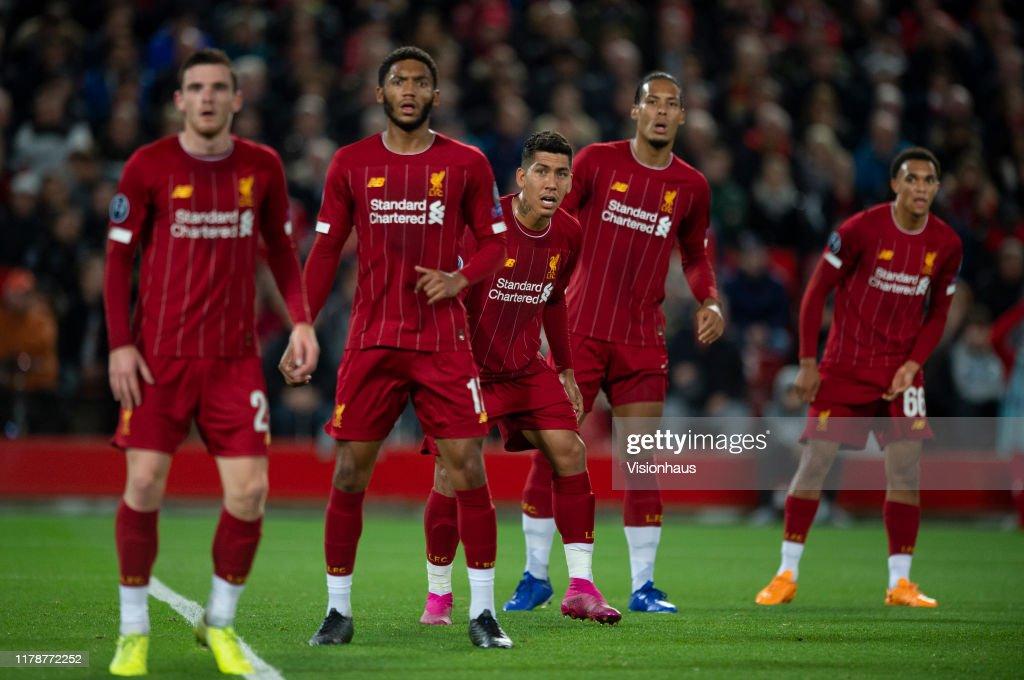 Liverpool players Andy Robertson, Joe Gomez, Roberto Firmino ...