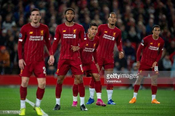 Liverpool players Andy Robertson Joe Gomez Roberto Firmino Virgil van Dijk and Trent AlexanderArnold wait for a corner to be taken during the UEFA...