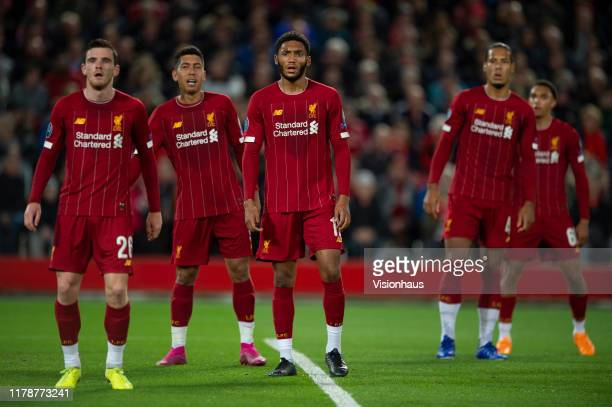 Liverpool players Andy Robertson Joe Gomez Roberto Firmino Virgil van Dijk and Trent AlexanderArnold wait for a corner to be taken during the UEFA...