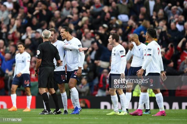 Liverpool players appeal to English referee Martin Atkinson after he allows the opening goal despite a foul on Liverpool's Belgium striker Divock...