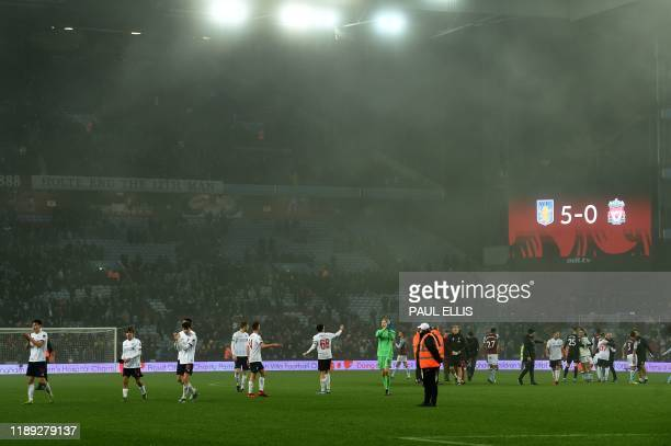 Liverpool players applaud their fans following their 50 defeat in the English League Cup quarterfinal football match between Aston Villa and...
