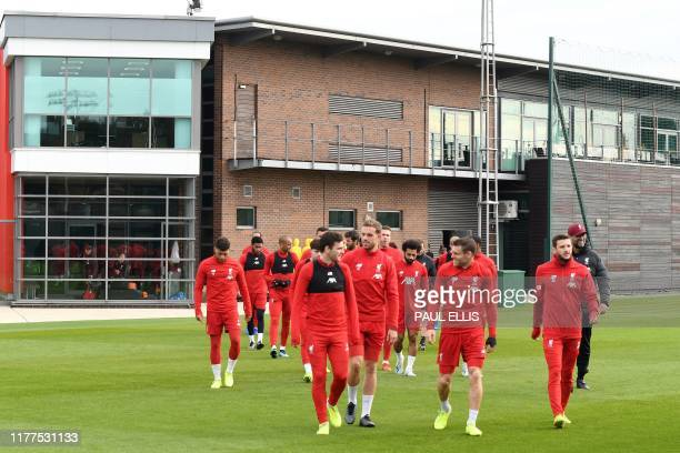 Liverpool players attend a team training session at Melwood in Liverpool north west England on October 22 on the eve of their UEFA Champions League...
