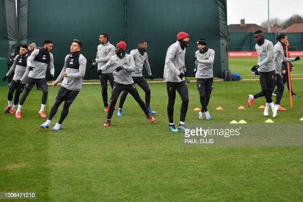 Liverpool players attend a training session at Melwood in Liverpool, north west England on March 10 on the eve of their UEFA Champions League last 16...