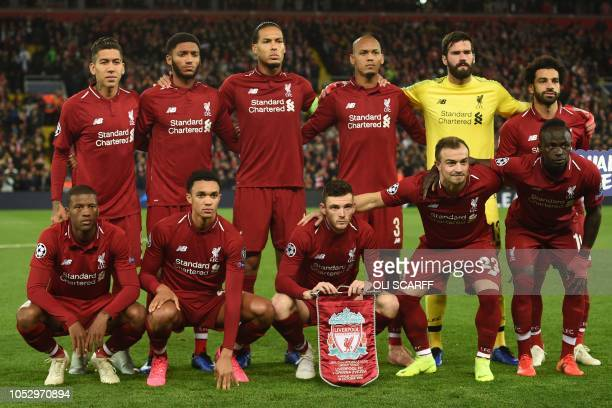 Liverpool players back row Liverpool's Brazilian midfielder Roberto Firmino Liverpool's English defender Joe Gomez Liverpool's Dutch defender Virgil...