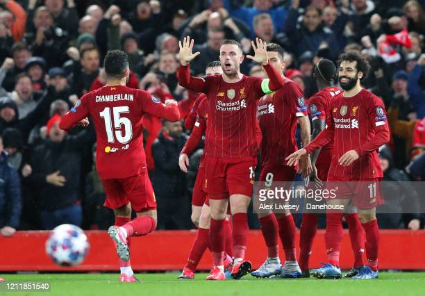 Liverpool players celebrate after Georginio Wijnaldum of Liverpool scores the opening goal during the UEFA Champions League round of 16 second leg...