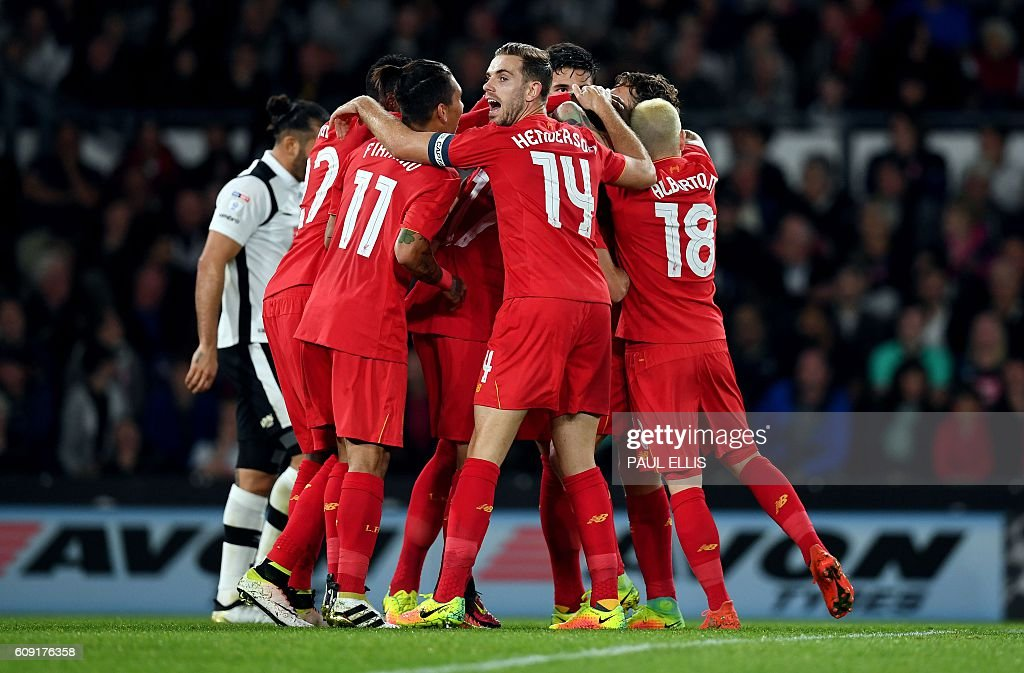 Liverpool players celebrate after Liverpool's Estonian defender Ragnar Klavan (C hidden) scored the opening goal during the English League Cup third-round football match between Derby County and Liverpool at iPro Stadium in Derby, central England on September 20, 2016. / AFP / PAUL ELLIS / RESTRICTED TO EDITORIAL USE. No use with unauthorized audio, video, data, fixture lists, club/league logos or 'live' services. Online in-match use limited to 75 images, no video emulation. No use in betting, games or single club/league/player publications. /