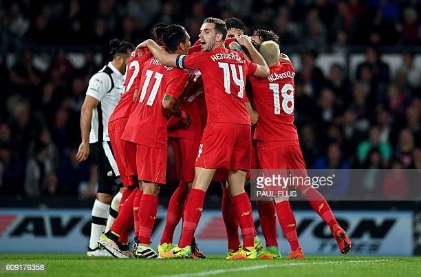 Liverpool players celebrate after Liverpool's Estonian defender Ragnar Klavan scored the opening goal during the English League Cup thirdround...