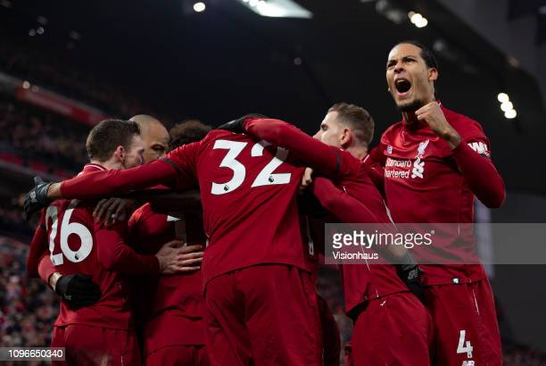 Liverpool players celebrate after Roberto Firmino scores during the Premier League match between Liverpool FC and Crystal Palace at Anfield on...