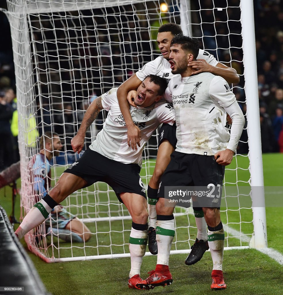 Liverpool players celebrate after scoring the Ragnar Klavan scores the winning goal during the Premier League match between Burnley and Liverpool at Turf Moor on January 1, 2018 in Burnley, England.