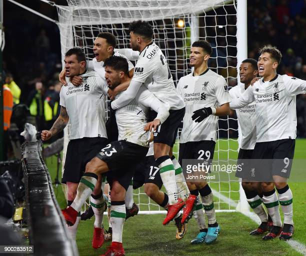 Liverpool players celebrate after scoring the Ragnar Klavan scores the winning goal during the Premier League match between Burnley and Liverpool at...