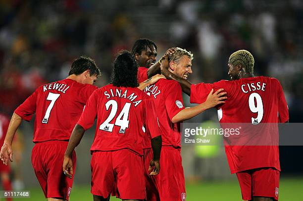 Liverpool players celebrate after they scored a goal to go up 40 over Celtic July 26 2004 at Rentschler Field in East Hartford Connecticut Liverpool...