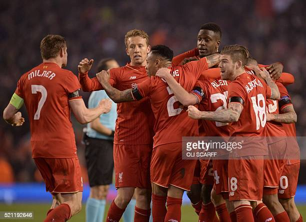 Liverpool players celebrate after winning the UEFA Europa league quarterfinal second leg football match between Liverpool and Borussia Dortmund at...