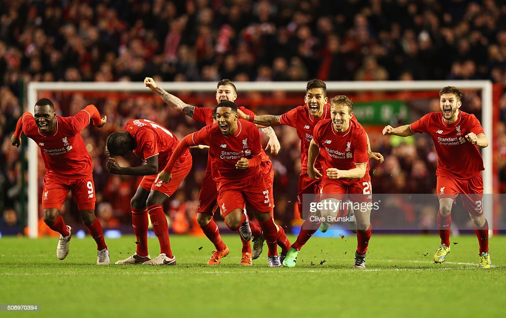 Liverpool players celebrate as Joe Allen of Liverpool scores the decisive penalty in the shoot out during the Capital One Cup semi final second leg match between Liverpool and Stoke City at Anfield on January 26, 2016 in Liverpool, England. Liverpool win 6-5 on penalties after extra time.