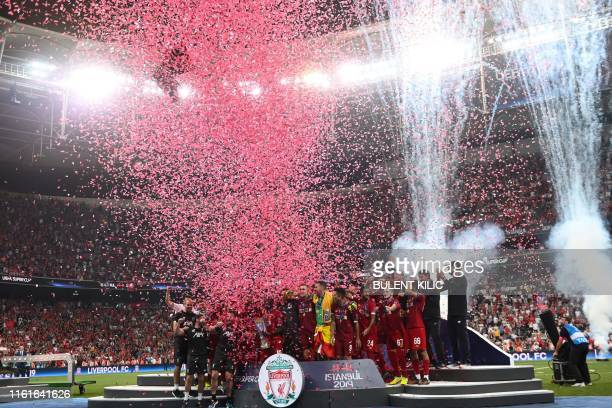 Liverpool players celebrate on the podium after winning the UEFA Super Cup 2019 football match between FC Liverpool and FC Chelsea at Besiktas Park...