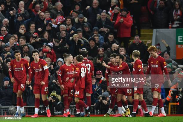 Liverpool players celebrate taking the lead through an owngoal during the English FA Cup fourth round reply football match between Liverpool and...