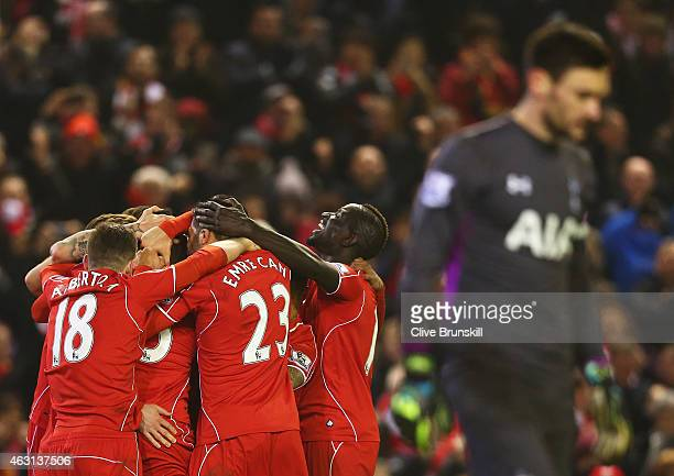 Liverpool players celebrate the goal scored by Mario Balotelli during the Barclays Premier League match between Liverpool and Tottenham Hotspur at...