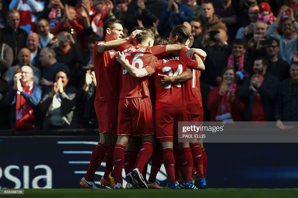 Liverpool players celebrate the opening goal scored by Liverpool's English striker Daniel Sturridge during the English Premier League football match between Liverpool and Newcastle United at Anfield in Liverpool, north west England on April 23, 2016. / AFP / PAUL ELLIS / RESTRICTED TO EDITORIAL USE. No use with unauthorized audio, video, data, fixture lists, club/league logos or 'live' services. Online in-match use limited to 75 images, no video emulation. No use in betting, games or single club/league/player publications. /
