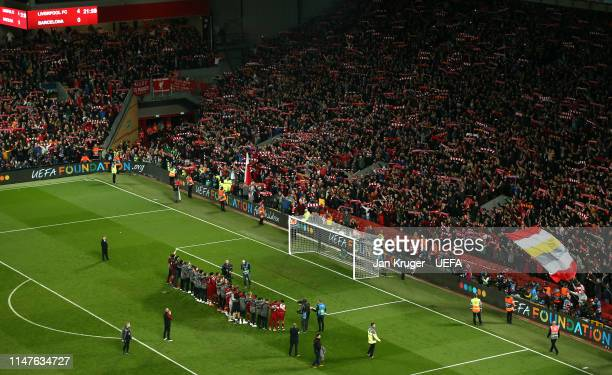 Liverpool players celebrate the win with their fans during the UEFA Champions League Semi Final second leg match between Liverpool and Barcelona at...