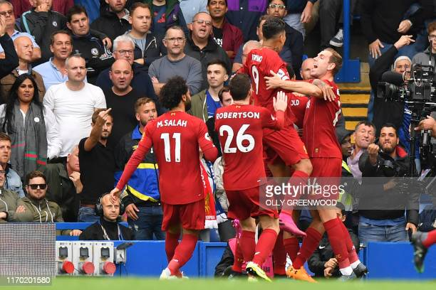 Liverpool players celebrate their first goal during the English Premier League football match between Chelsea and Liverpool at Stamford Bridge in...