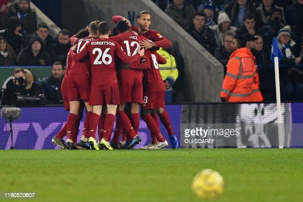Liverpool players celebrate their opening goal during the English Premier League football match between Leicester City and Liverpool at King Power...