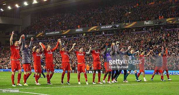 Liverpool players celebrate victory after the UEFA Europa League quarter final second leg match between Liverpool and Borussia Dortmund at Anfield on...