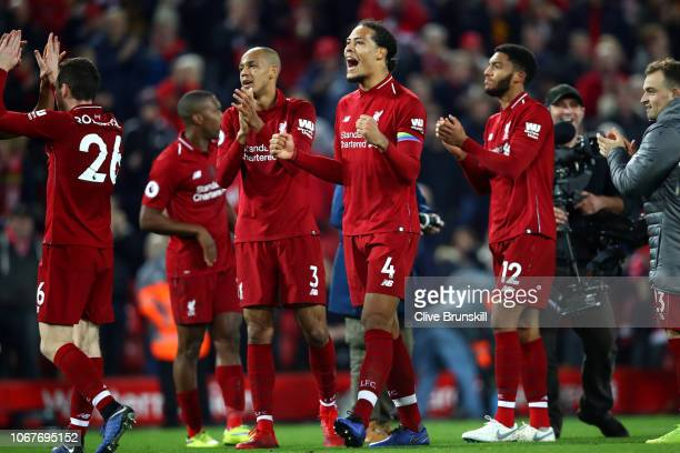 Liverpool players celebrate victory following the Premier League match between Liverpool FC and Everton FC at Anfield on December 2 2018 in Liverpool...