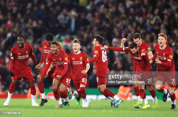 Liverpool players celebrate winning the penalty shootout in the Carabao Cup Fourth Round match at Anfield Liverpool
