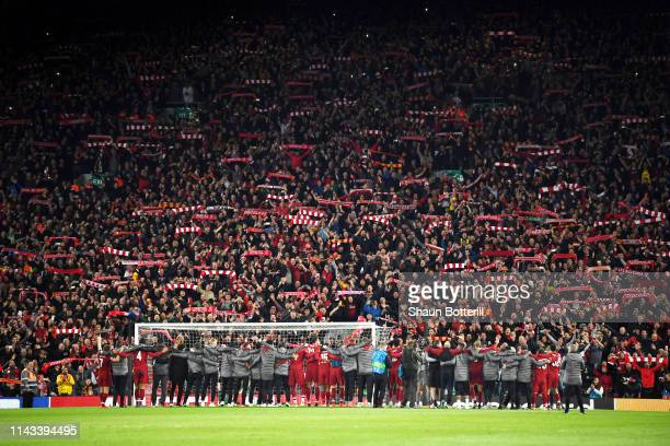 Liverpool players celebrate with fans after the UEFA Champions League Semi Final second leg match between Liverpool and Barcelona at Anfield on May...