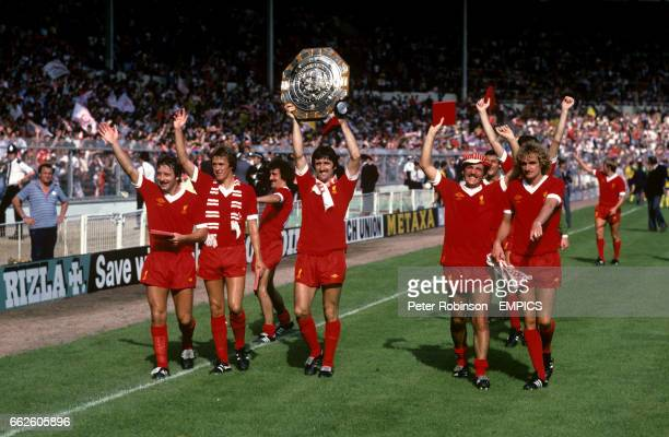 Liverpool players celebrate with the charity shield Jimmy Case Phil Neal Terry McDermott David Johnson Alan Kennedy and Phil Thompson