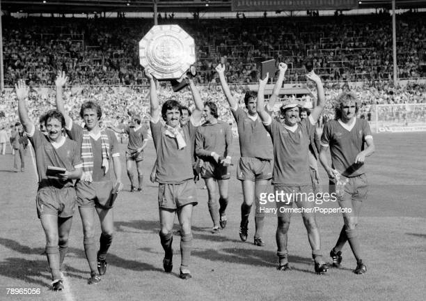Liverpool players celebrate with the trophy after the FA Charity Shield between Arsenal and Liverpool at Wembley Stadium on August 11, 1979 in...