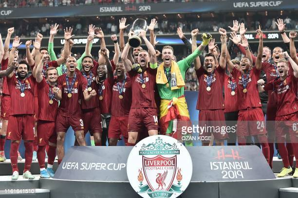 Liverpool players celebrate with the trophy after winning the UEFA Super Cup 2019 football match between FC Liverpool and FC Chelsea at Besiktas Park...