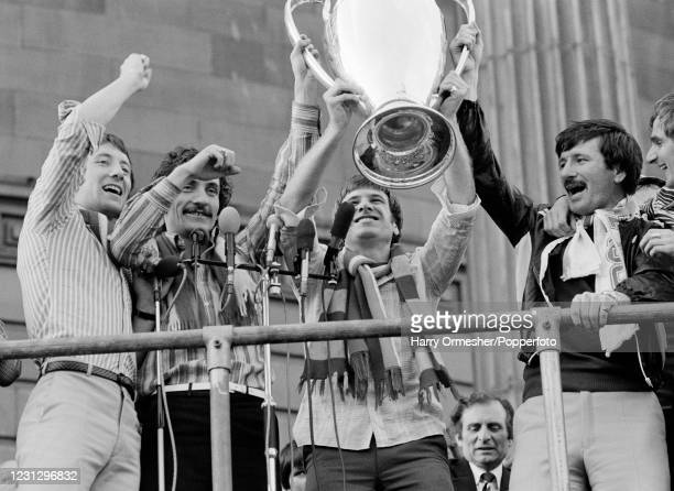 Liverpool players celebrate with the trophy at the civic reception after the bus parade following their European Cup victory, on May 26, 1977 in...