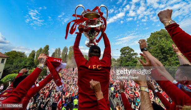 Liverpool players celebrating after winning the UEFA Champions League at the parade on June 02, 2019 in Liverpool, England.