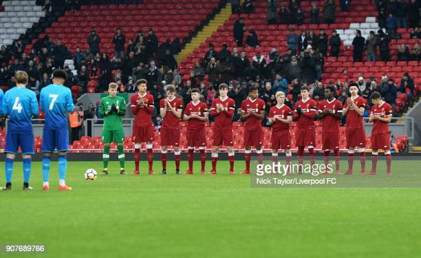Liverpool players during a minute's applause for Cyril Regis before the FA Youth Cup fourth round match between Liverpool and Arsenal at Anfield on...