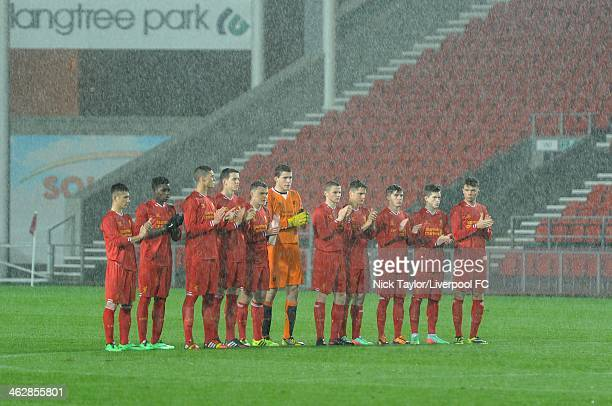 Liverpool players during a minute's applause held in memory of former Academy player Thomas Stocks before the FA Youth Cup Fourth Round fixture...
