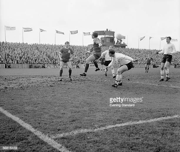 Liverpool players Ian St John and Roger Hunt miss the ball in a muddy penalty area during a game at Craven Cottage 26th February 1966 Fulham won the...