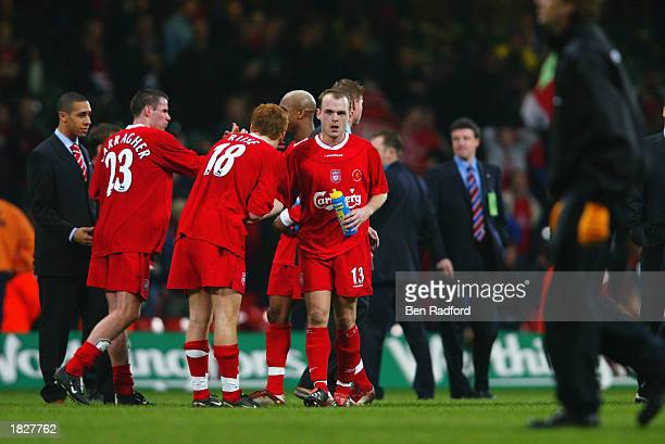 Liverpool players Jamie Carragher, John Arne Riise and Danny Murphy celebrate victory after the Worthington Cup Final between Liverpool and...