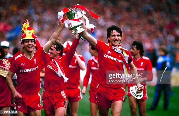 Liverpool players Jim Beglin and Alan Hansen parade the FA Cup trophy after the FA Cup Final between Liverpool and Everton held on May 10 1986 at...