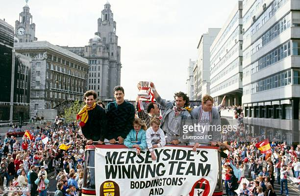 Liverpool players Jim Beglin Ian Rush Bruce Grobbelaar Craig Johnston and Steve McMahon celebrate being the FA Cup and Canon League Division One...